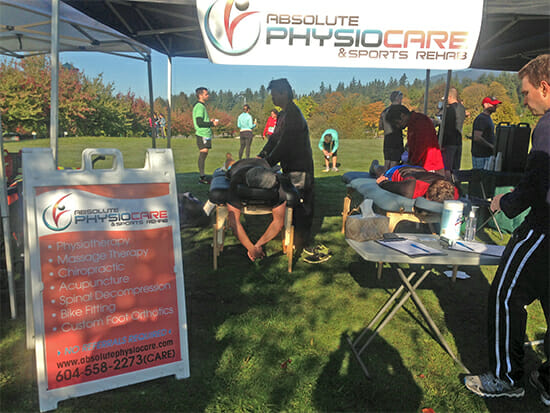 Ryan Wong, massage therapist and I (Reza Ghannadan, physiotherapist) from Burnaby PhysioCare & Sports Rehab providing treatment for injured runners.